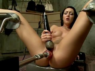 Hot petite babe fucks big dildo machine