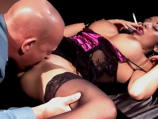 Romana Ryder is a smashing brunette with abounding in assets who likes to get fucked while smoking